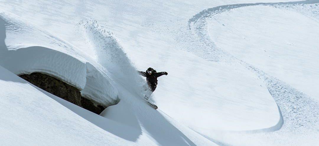 snowboarder heel side poder slash